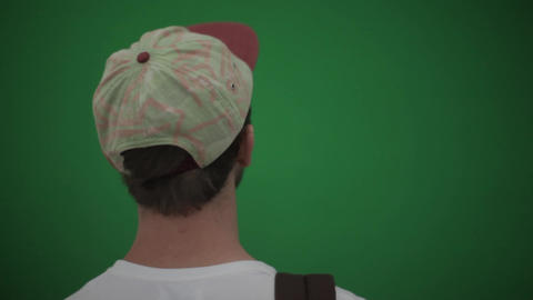 The guy in the cap on a green background. Chromekey Live Action