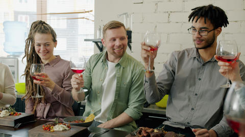 Cheerful people multi-ethnic group toasting clinking wine glasses drinking and Live Action