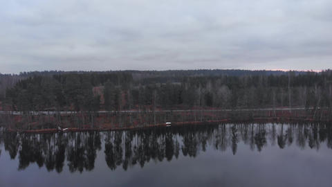 Finland lake shore approach trees reflections in autumn dusk Live Action
