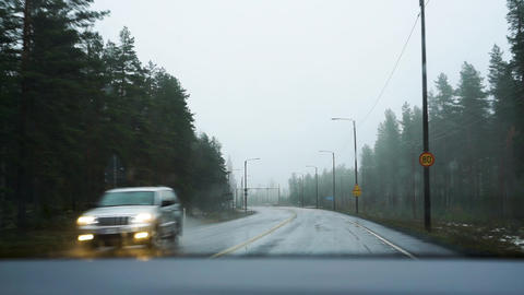 Driving on rainy autumn road in Finland road work signs dashboard view Live Action