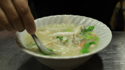 Seafood mush or seafood boiled rice , Traditional Asian style food Live Action