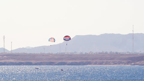 Timelapse tourists on a parachute over the sea. Parasailing in the red sea Live Action