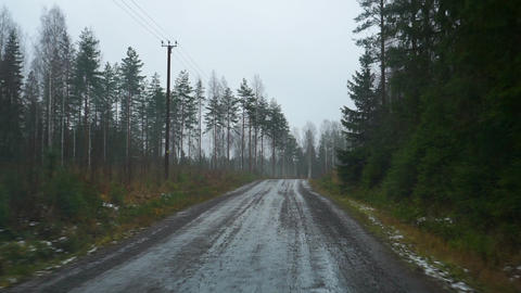 Car windscreen view of gravel road drive in Finland in autumn Live Action