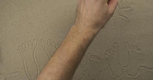 Drawing in the sand in real time. Beach drawing for leisure and travel Live Action