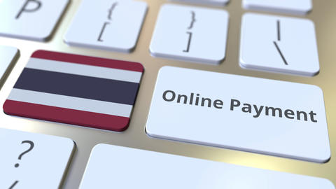 Online Payment text and flag of Thailand on the keyboard. Modern finance related Live Action