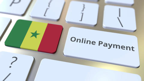Online Payment text and flag of Senegal on the keyboard. Modern finance related Live Action