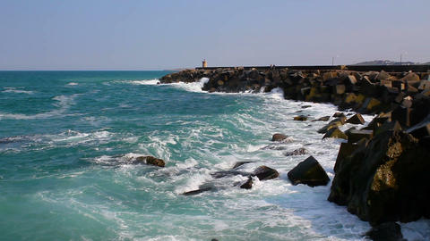 Sea ocean waves crash into the breakwater. Sunny summer day sea wave landscape Live Action