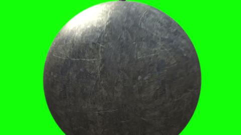 Metallic Wrecking Ball Shattering The Concrete Wall. Front View GIF