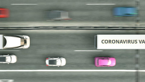 Aerial top down shot of trailer trucks delivering coronavirus vaccine. Loopable Live Action