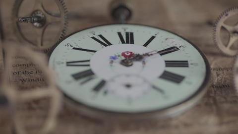 Macro shot of an antique vintage clock depicting the clock face, hands of the clock, second hand in Live Action