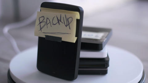 portable hard disk backup cloud drive or physical back-up background Live Action