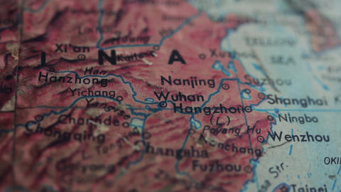 Wuhan and China in an Old Earth Globe Map. Close-up. Zoom In Live Action