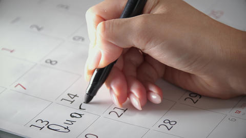 Write quarantine to the calendar with black felt-tip pen Live Action