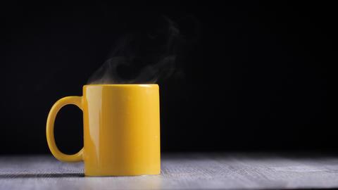 Hot water in yellow mug with steam smoke GIF
