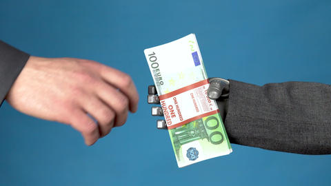 Cyborg businessman in a suit holds out a wad of euros to a man. Businessman Live Action