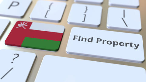 Find Property text and flag of Oman on the keyboard. Online real estate service Live Action