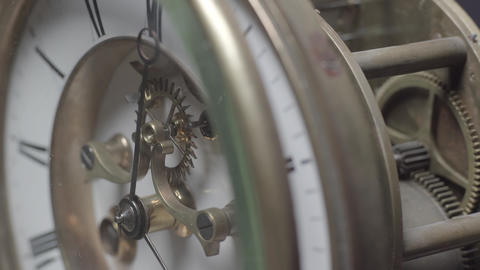 Macro shot of an antique vintage clock with a detailed depiction of the clock face Live Action