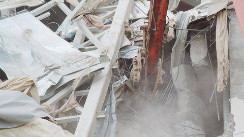 excavator with cutter disassembles debris rubble of arena Live Action