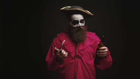 Drunk bearded man dressed up like a pirate with a hook Live Action