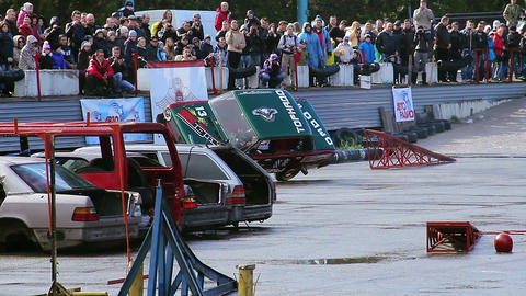 Car driver performing two-wheel driving at extreme stunt show Live Action