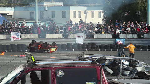 Stunt car flips over, explodes. Thrilled audience. Part2of2 Footage