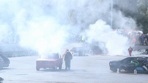 Rescue team extinguishes car fire, stunt show, sporting event Footage