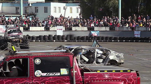 Bigfoot truck entertaining viewers at show, fun, extreme sports Live Action