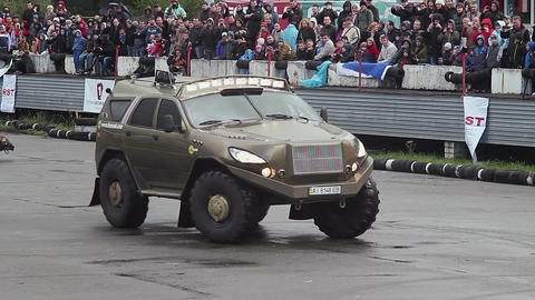 Huge off-road custom truck drifting in front of thrilled crowd Live Action
