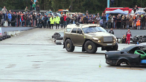 Bigfoot custom monster truck drifting at arena, crowd watching Live Action