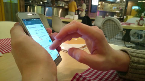 Man surfing websites on touch phone using applications indoor Footage