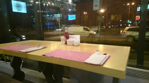Empty table at restaurant, loneliness, city traffic outside Footage