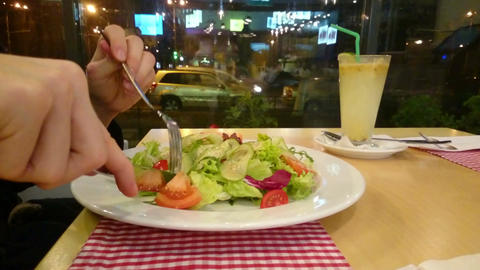 Man eating fresh vegetable salad at restaurant, healthy food Footage