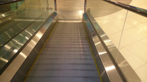 Escalator slowly moving down, reaching end, shopping mall Footage