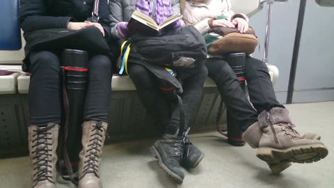 Ordinary people in subway, commuters sitting in metro train Footage
