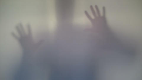 Terrifying male silhouette emerging, flashing, scary gestures Footage