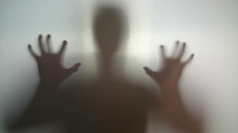 Mysterious silhouette with hands up and down, person in stress Live Action