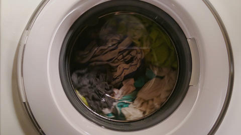 Washing machine full of clothes, home appliance, laundromat Footage