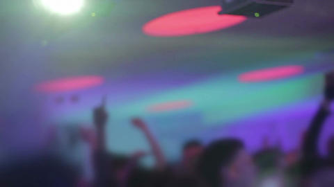 Music driving people crazy at nightclub, hands in air, euphoria Footage