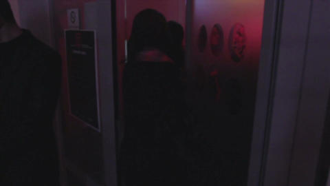 Young people entering, leaving night club, open, close door Footage