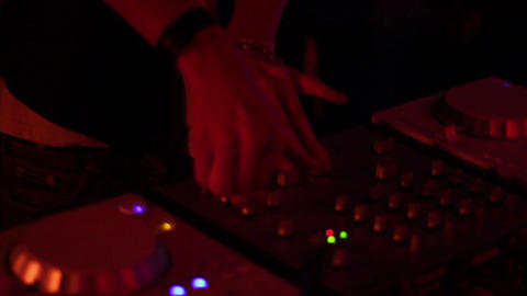 Female DJ hands mixing records, girl playing music at nightclub Footage