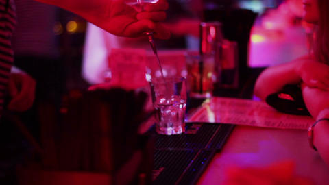 Barman working, pouring, serving alcohol drinks to bar guests Footage