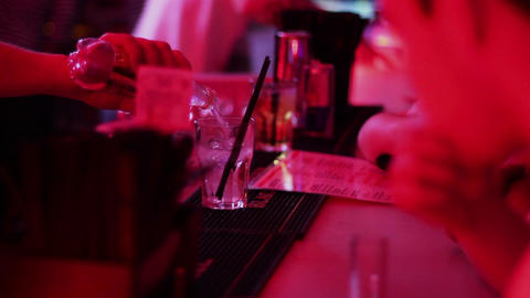 Bartender hands pouring drink, serving clients, nightclub bar Footage