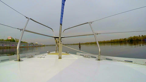 Sailboat passing buoy on wide city river, sailing, yachting, POV Footage