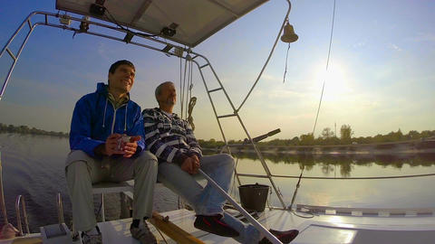 Couple of men yachting on river, friendship, hobby, tourism Live Action