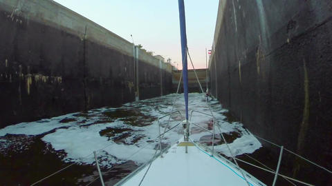 Canal lock filling with dirty water. Boats, transport, industry Footage