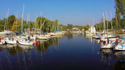Summer, beautiful yachts moored in quiet city harbor, vacation Footage