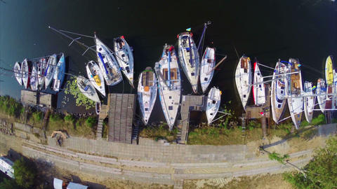Aerial of many sailboats in small harbor, yacht maintenance Footage