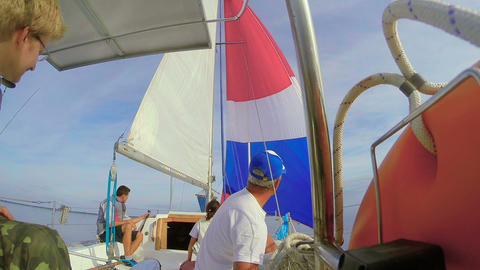 Four people crew on sailing yacht, open sea, traveling, vacation Footage