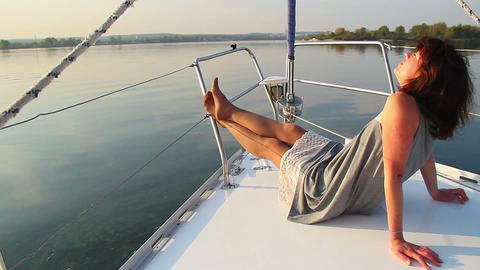Pretty female lying on deck of sailing yacht, enjoying rest Footage