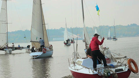 Yachts and sailboats on wide city river, sports, sailing, summer Footage